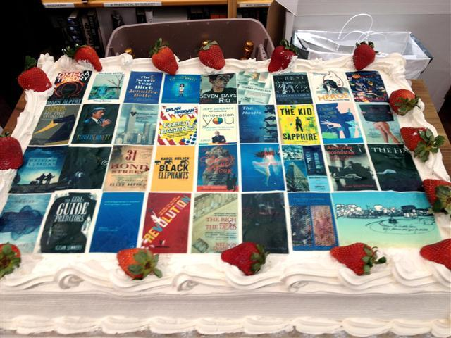 A strawberry  shortcake from Venerio's with replicas in sugar of books published by Writers Room members.