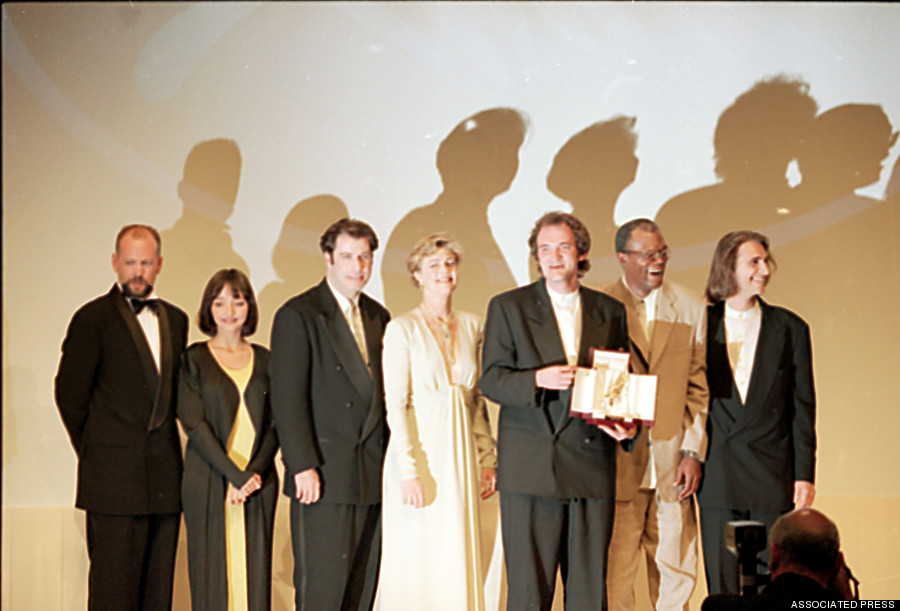 "Quentin Tarantino holding the Palm d'Or alongside the cast of ""Pulp Fiction"" at the 1994 Cannes Film Festival"